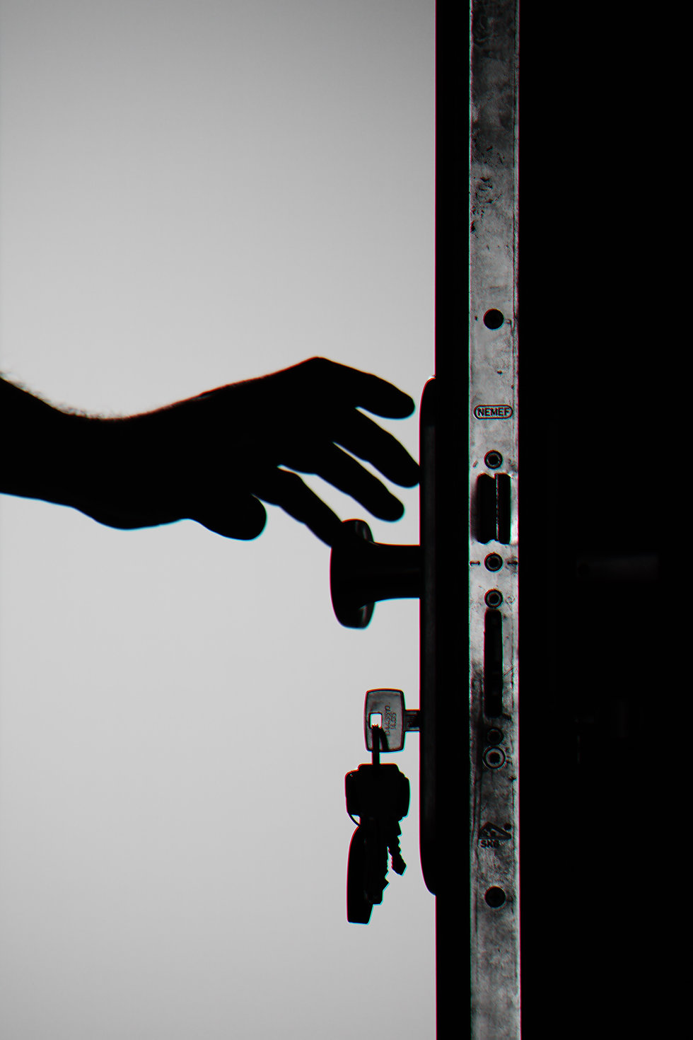 silhouette-photo-of-person-holding-door-
