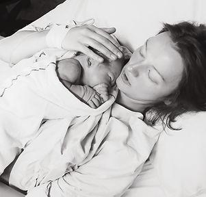 Mother holding her newborn baby child af