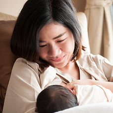 Mother breastfeeding her newborn baby be