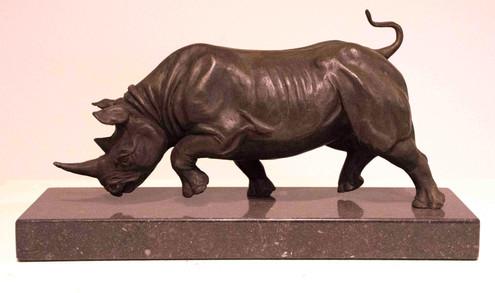 Charging rhino bronze sculpture