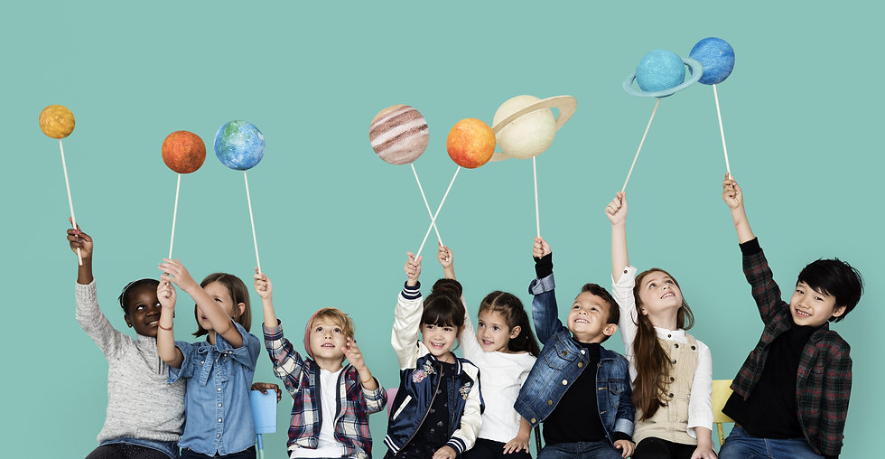 Diverse group of kids holding planets on