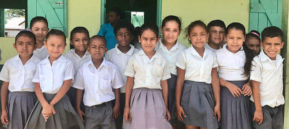 BROOKE RAMOS / GLOBAL AID CONSULTANTS Students of St. Matthew's Government School stand outside of their classroom for a photo.