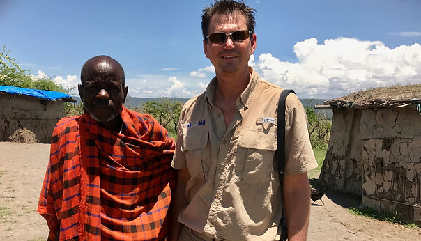 GLOBAL AID CONSULTANTS Global Aid Consultants Co-Founder Todd Speer (on right) with MaasaiVillage Leader (on left) inTanzania. The importance andavailabilityof education for children was discussed.