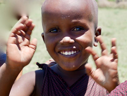 GLOBAL AID CONSULTANTS A happy Maasaichild holdsthe future of his tribein his hands.