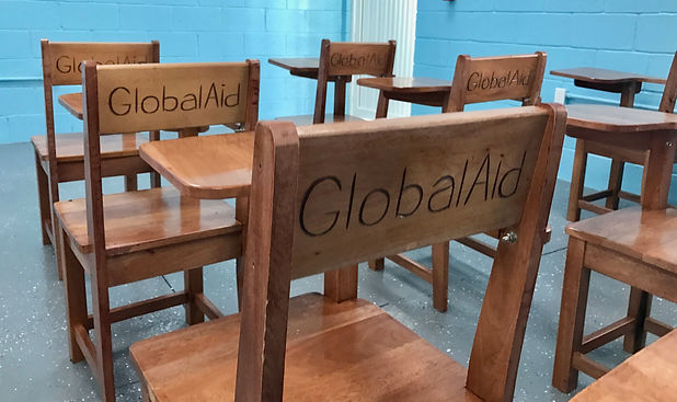BROOKE RAMOS / GLOBAL AID CONSULTANTS Global Aid Consultants bought the school desks locally to drive business into the local economy.