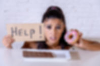 sad-woman-on-diet-holding-a-sign-help-re