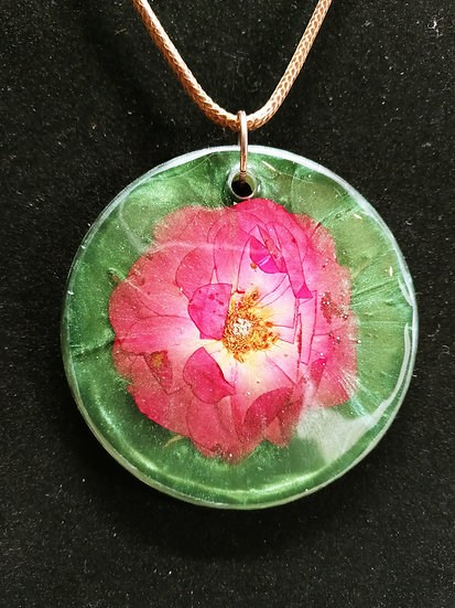 Green epoxy covered flower necklace