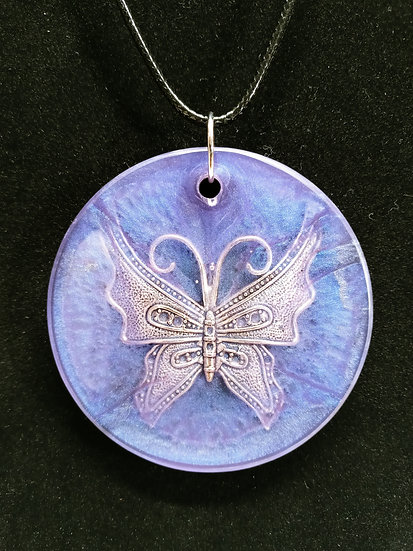 Metal butterfly in resin necklace