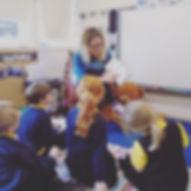Author reading to school children