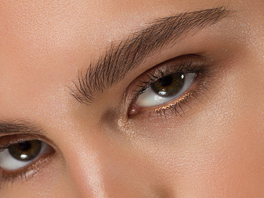 Close-up of woman's eyes with evening ma