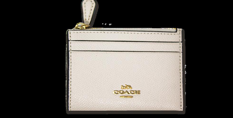 Monedero Coach blanco de piel