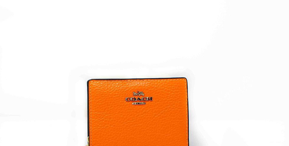 Monedero Coach naranja fluorescente de piel