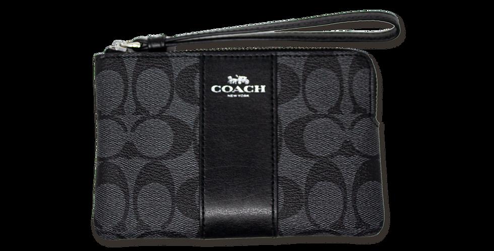 Muñequera Coach negra monogramada franja negra