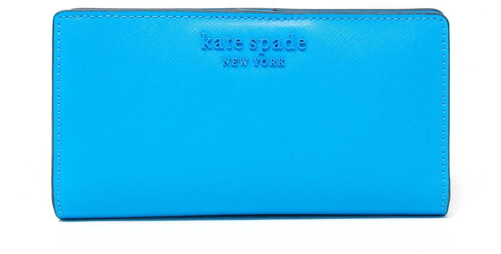 Cartera plegable Kate Spade azul claro de piel