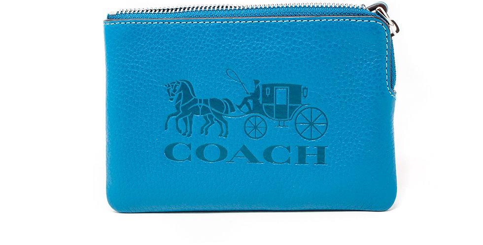 Muñequera Coach azul de piel logo