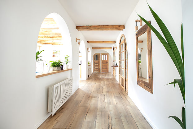 Wooden handmade mirror in hallway boho i