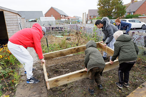 Placing one of the finished beds in place at Blakelaw Community Allotment.jpeg