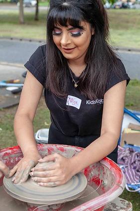 Kids Kabin volunteer Noor Amer demonstra
