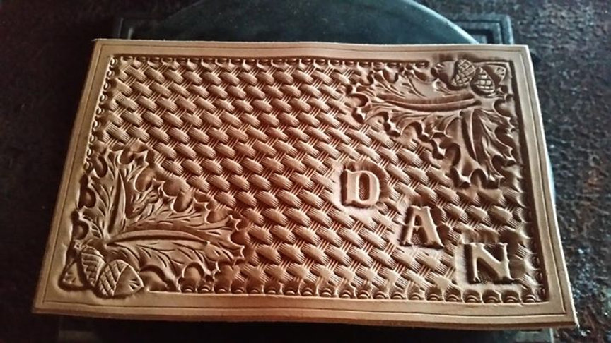 Just finished tooling this wallet cover