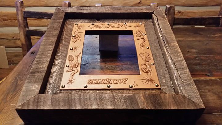 Rugged wood and leather picture frame.