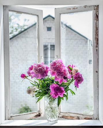 peonies on windowsill.jpg