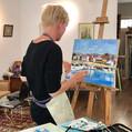 Olga Karlson is painting
