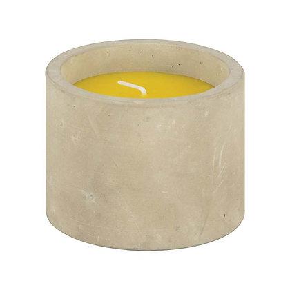 Bougie à la citronnelle dans un pot en béton