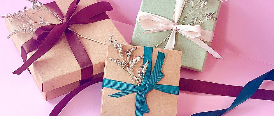 Gift box with ribbon and flower