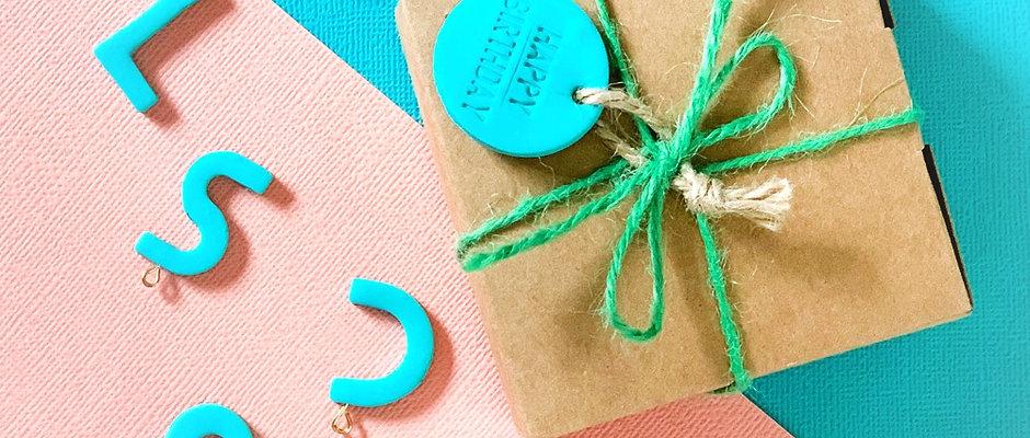 Gift box with ribbon and tags