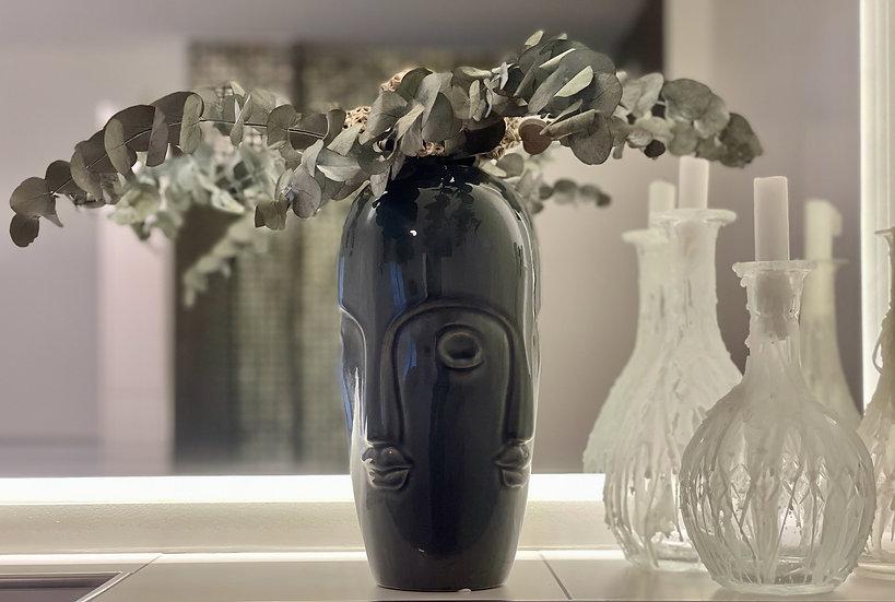 Vase mit Gesichtern