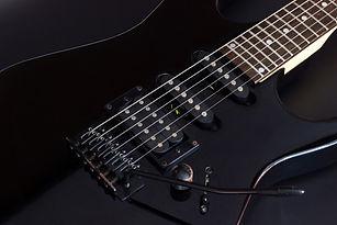 black-electric-guitar-close-up-dark-back