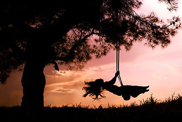 Tree with happy gir swinging