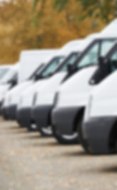 commercial delivery vans in row at parking place of transporting carrier shipping service company_ed