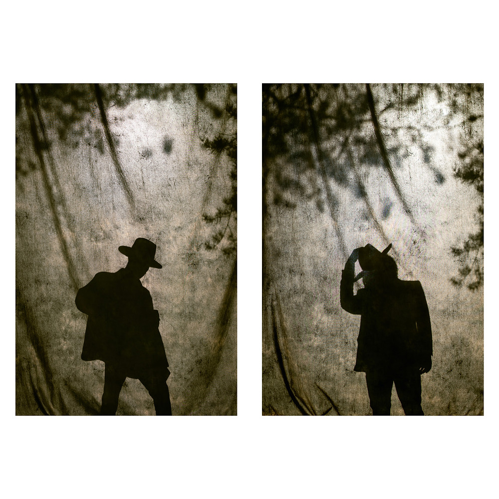 Silhouette of two cowboys