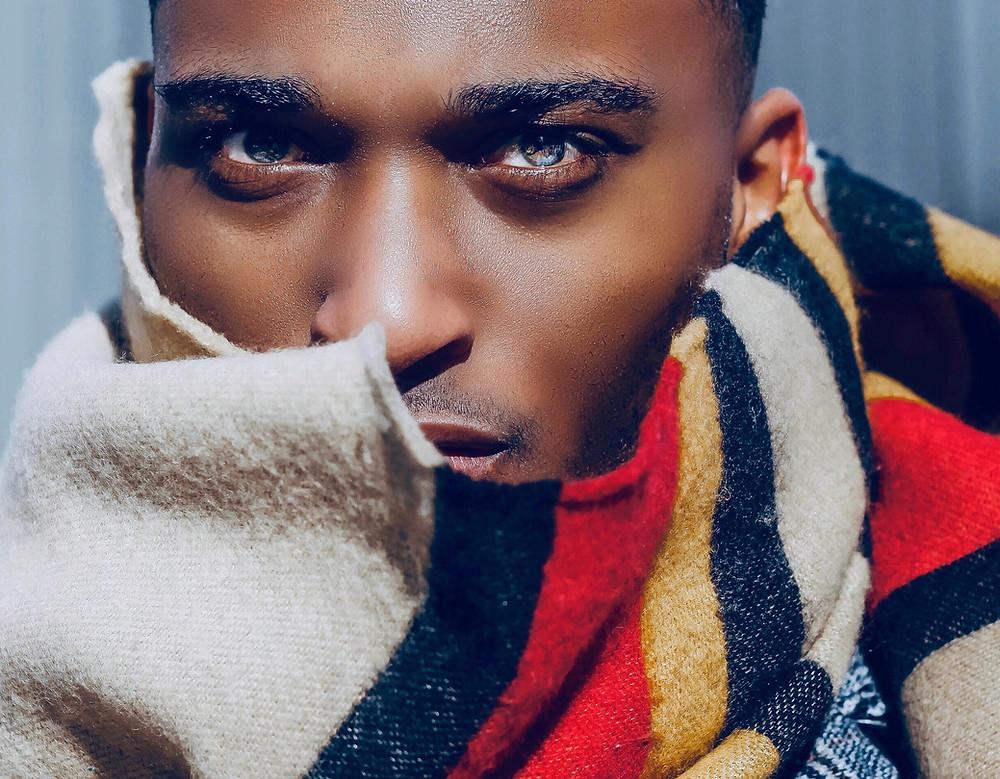 Black man posing in scarf