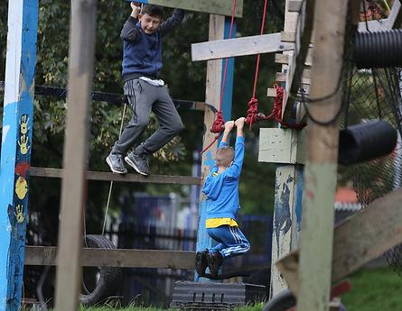 Boys playing on a climbing frame
