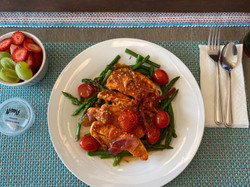 Sesame chicken over organic green beans and grape tomatoes