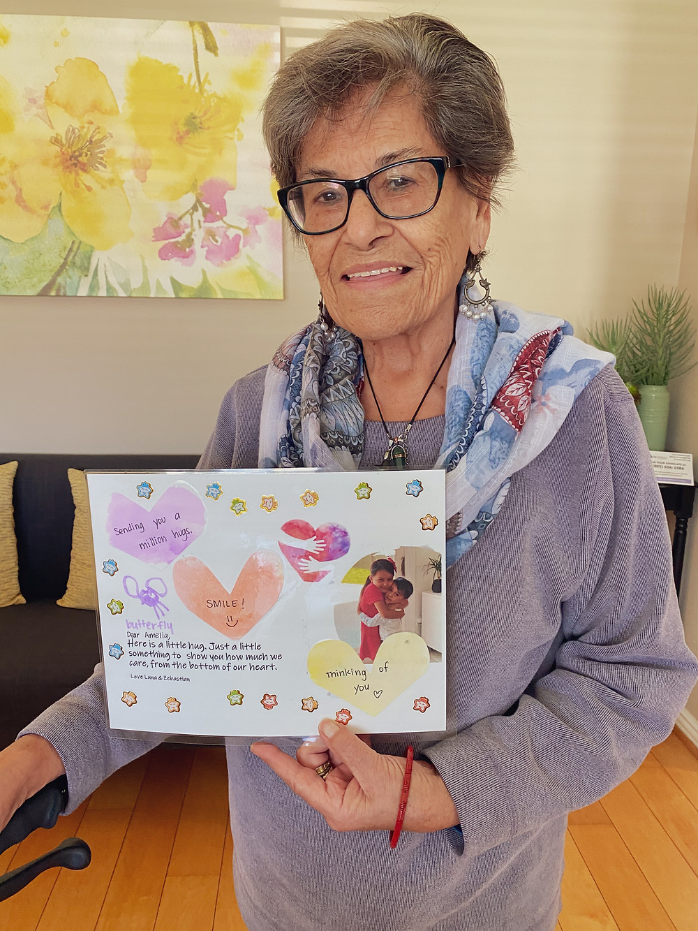 Elderly resident sharing a heartwarming card she received.