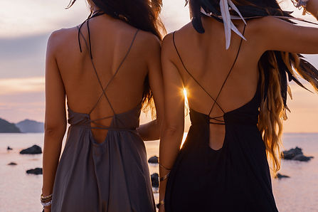 silhouette of two young beautiful girls
