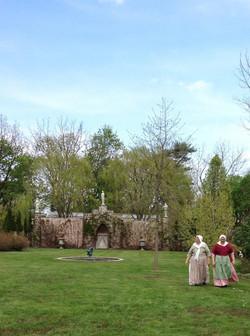 Ladies in Costume walking in Garden