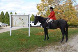 Linda Roberts on Horse near Intro sign
