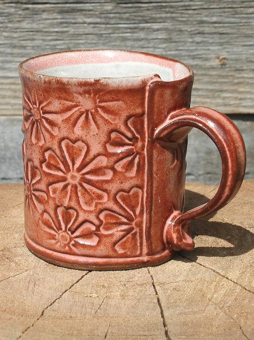 10 oz. Stoneware mug - flower motif / pink shino satin glaze