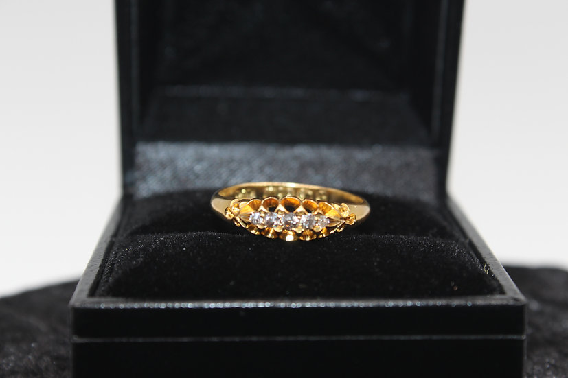 A 18ct gold diamond ring, size M, weighing 2.4g