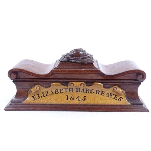 A mid-19th century mahogany sarcophagus-shaped pen box