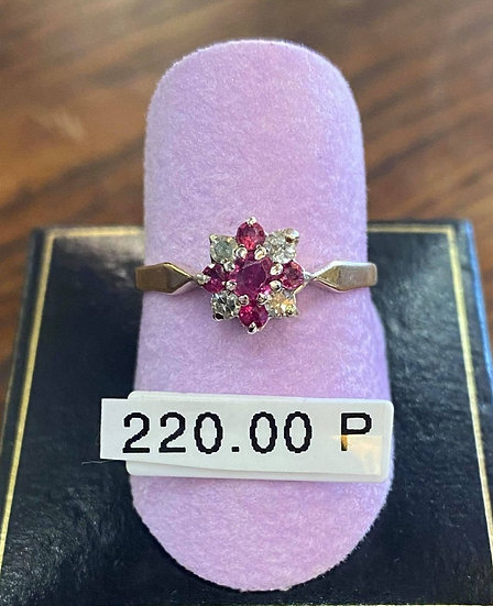 A 9ct white gold & ruby ring, size P, weighing 1.5g.