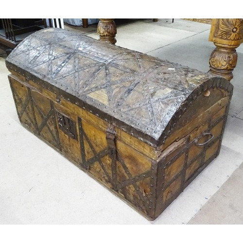 A 19th century leather and brass-studded dome-top travelling chest