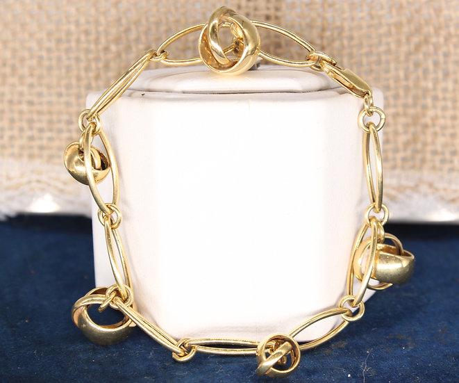 """A 7"""" 9ct gold link & spherebracelet"""