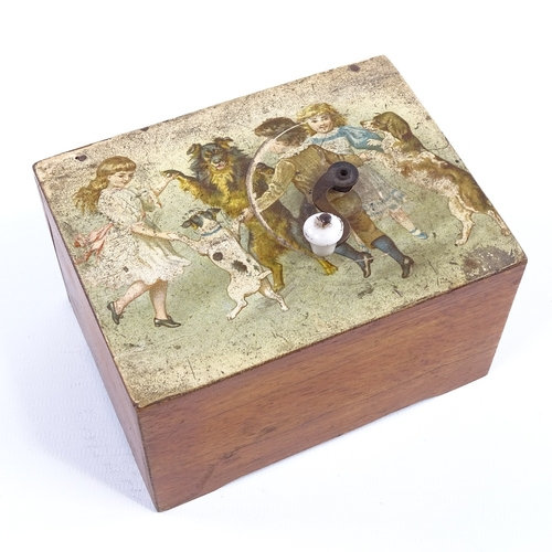 A Victorian musical box with transfer decorated top