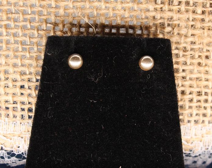 A pair of 9ct stud earrings, weighing 0.3g