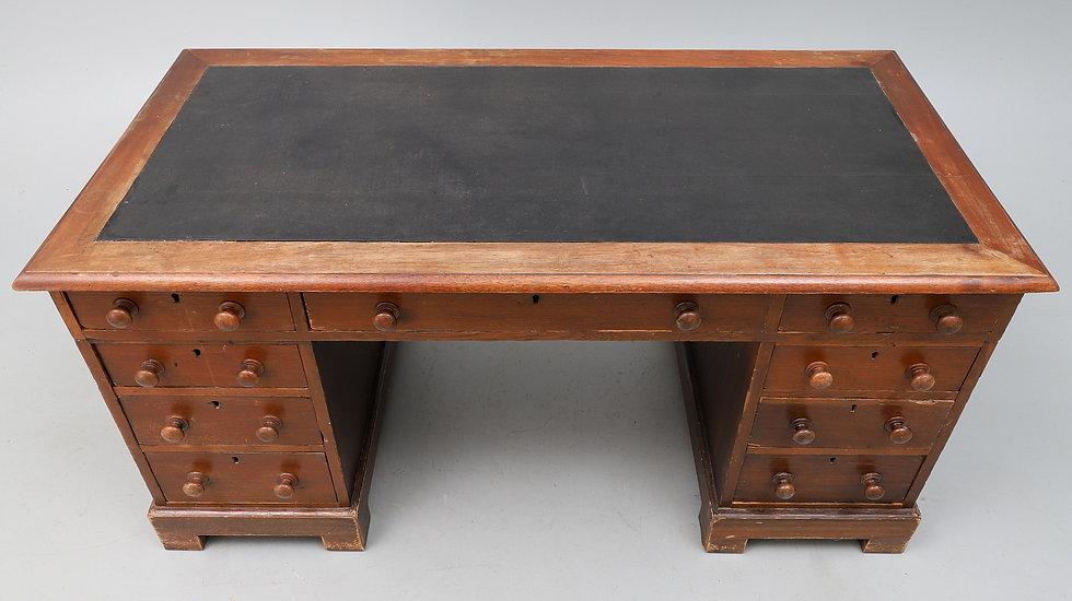 A Victorian oak kneehole desk